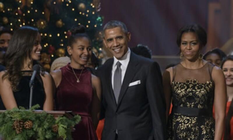 Las reflexiones de los Obama llegan en un momento de debate nacional sobre racismo en EU. (Foto: AFP )