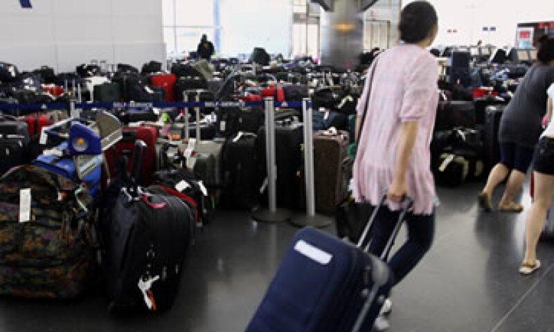 En el portal de Aduana México hay más información sobre la mercancía que puede ingresarse como equipaje. (Foto: AP)