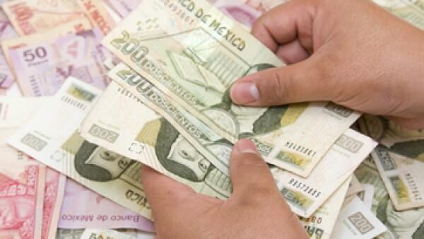 El analista mantiene su pronóstico de que el peso cerrará el año por debajo de los 13 pesos por dólar. (Foto: Getty Images)