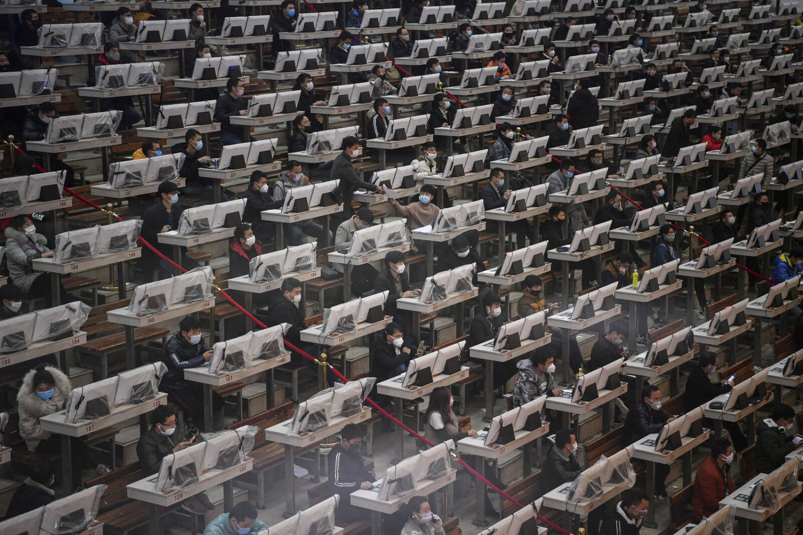 Traders wearing face masks are seen on the trading floor at a flower auction trading centre following an outbreak of the novel coronavirus in the country, in Kunming