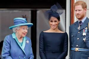 Reina Isabel, príncipe Harry y Meghan Markle