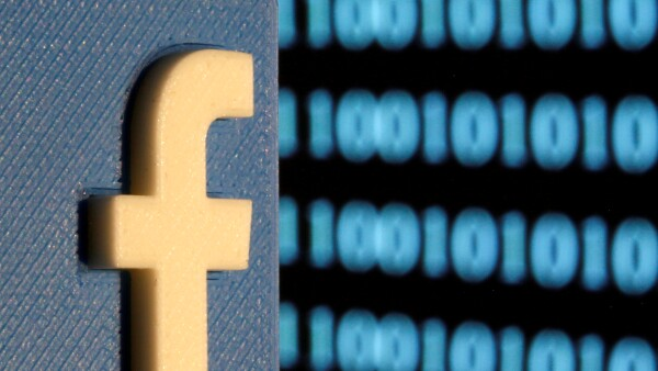 FILE PHOTO: A 3-D printed Facebook logo is seen in front of displayed binary code in this illustration picture