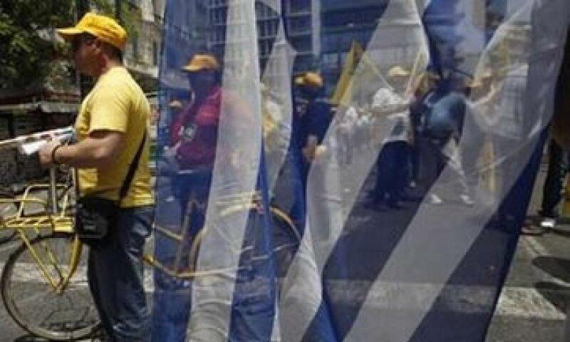 Analistas esperanq ue la economía se contraiga 5%. (Foto: Reuters)