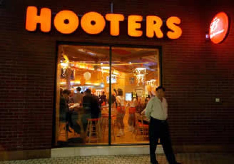 El acuerdo sumará 120 restaurantes de Hooters of America y 41 de Texas Wings. (Foto: AP)