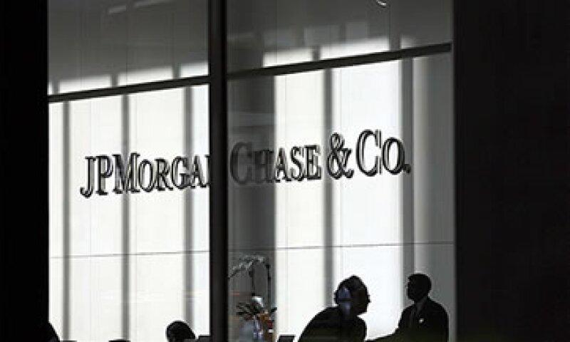 Las pérdidas se produjeron por la enorme exposición en derivados de crédito. (Foto: Cortesía CNNMoney)