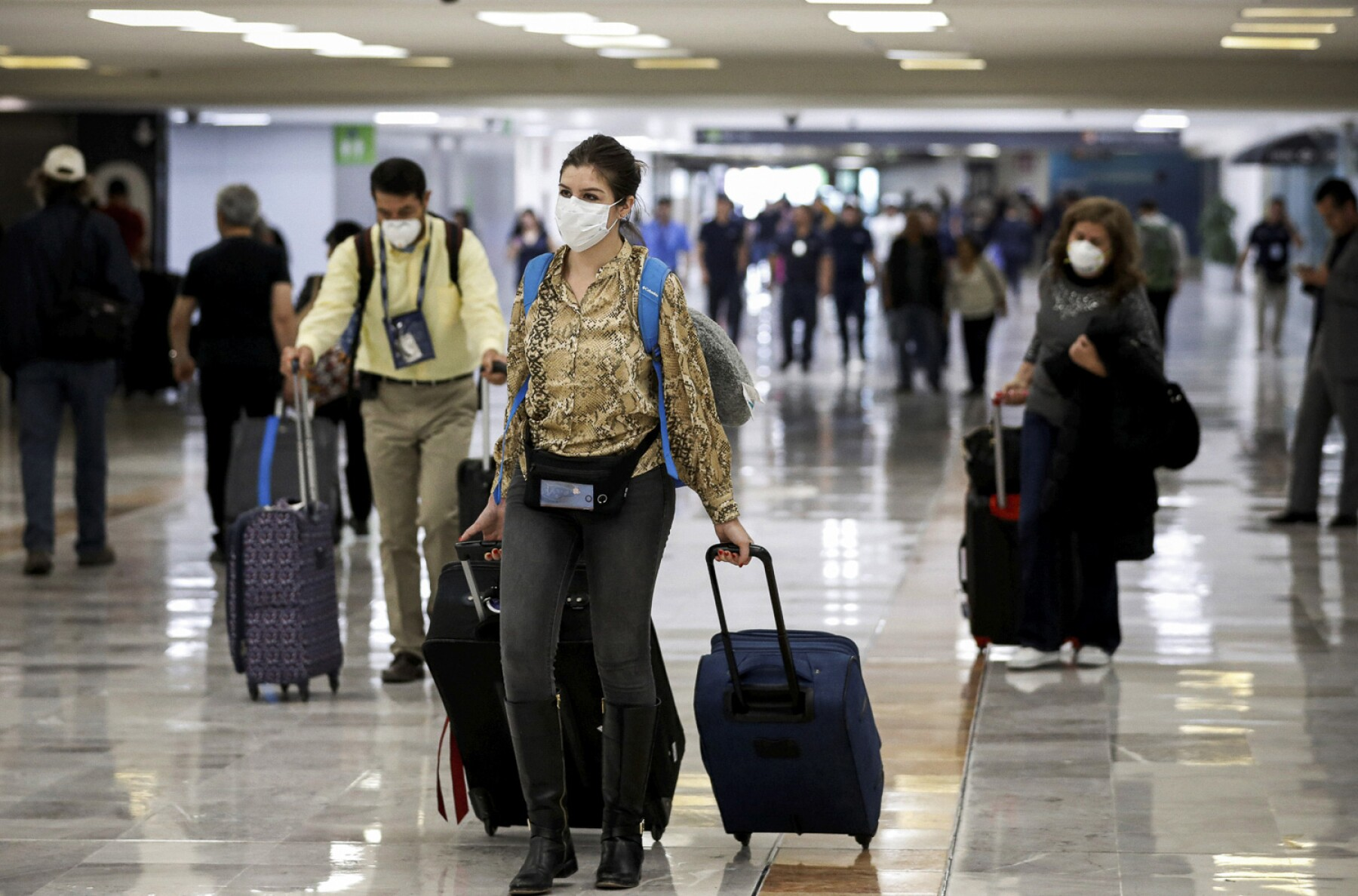 A stranded Peruvian tourist checks his phone at Cancun International Airport amid travel restrictions due to the outbreak of coronavirus disease (COVID-19) in Mexico