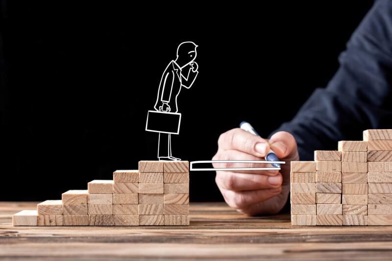Career Planning Concept. Businessman Getting Help Building Bridges To Success.