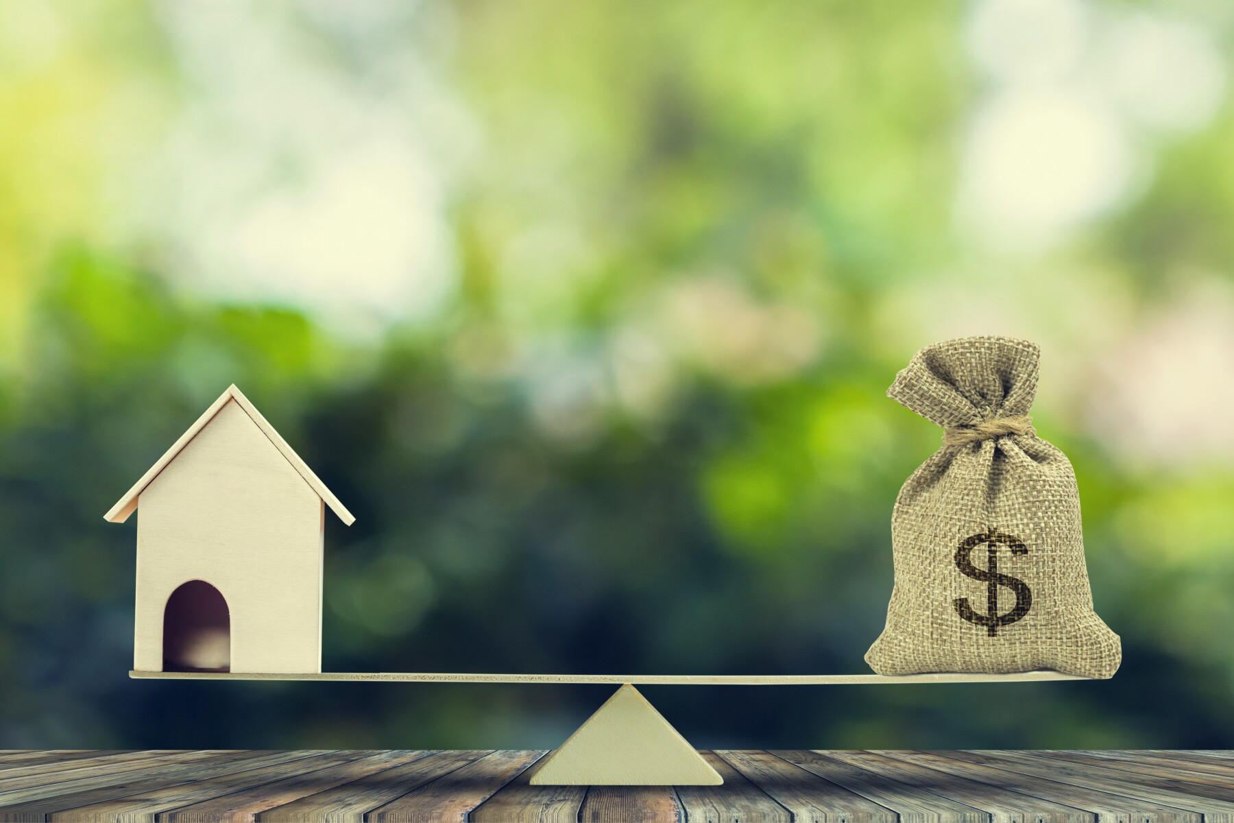 Money and home,loan,mortgage. Change home into cash concept.