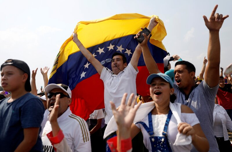 "People attend the ""Venezuela Aid Live"" concert at the Tienditas cross-border bridge between Colombia and Venezuela, in Cucuta"