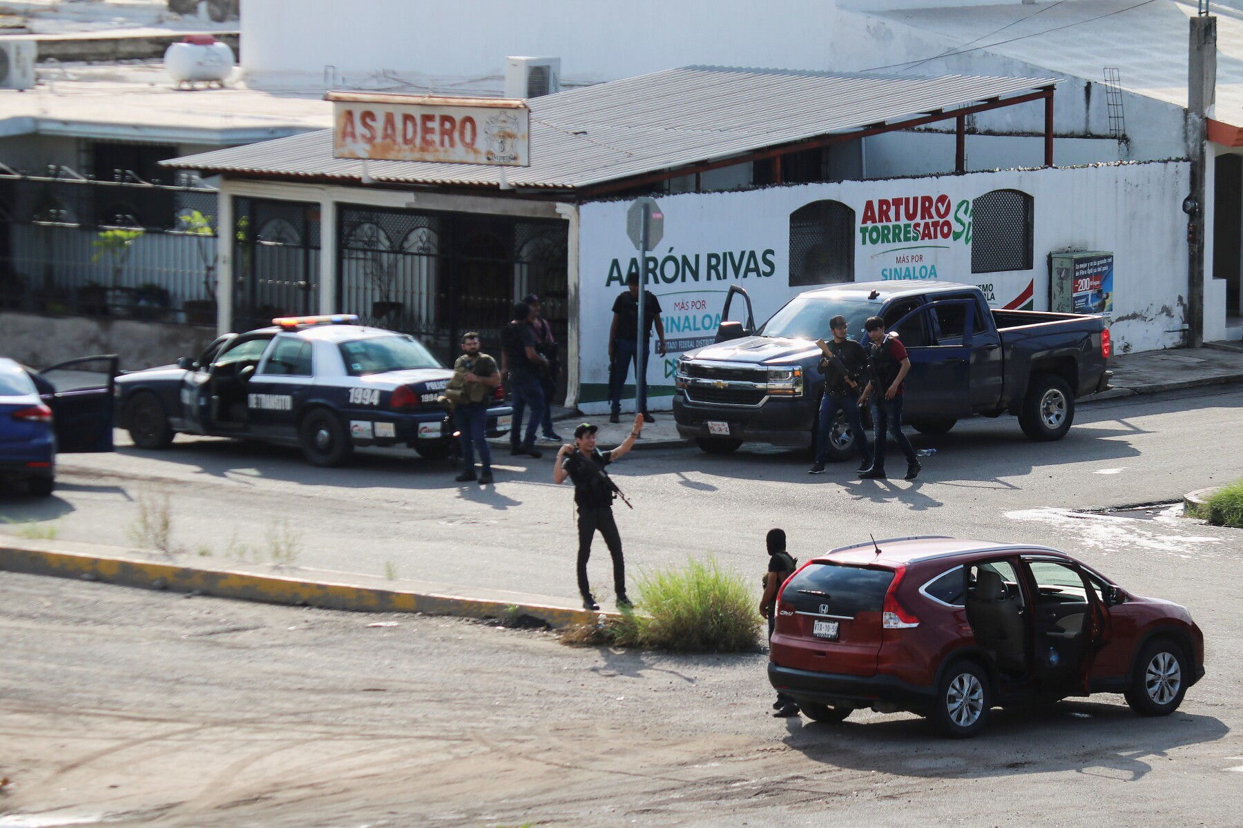 "Cartel gunmen are seen on a street during clashes with federal forces following the detention of Ovidio Guzman, son of drug kingpin Joaquin ""El Chapo"" Guzman, in Culiacan"