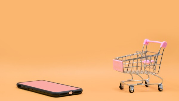 Smartphone and Cart on orange pastel background