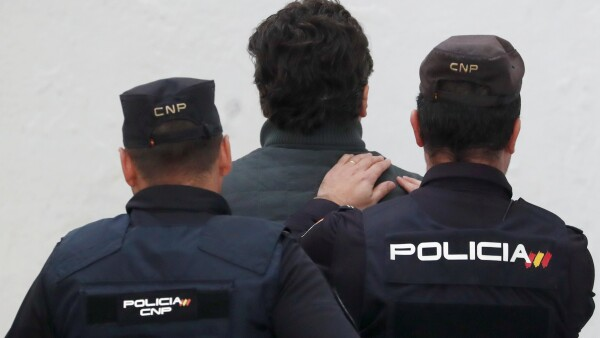 Former chief executive of Mexico's state oil firm Pemex, Emilio Lozoya, is escorted by Spanish police officers at a court in Marbella