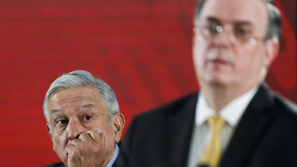 Mexico's President Andres Manuel Lopez Obrador looks at  Mexico's Foreign Minister Marcelo Ebrard during the daily news conference at National Palace in Mexico City