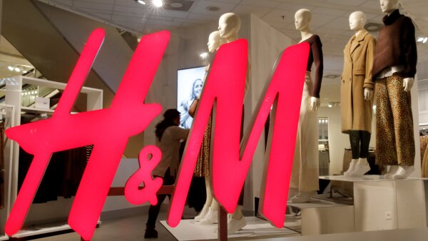 FILE PHOTO: Logo of H&M is seen in a display window of a store in Zurich, Switzerland