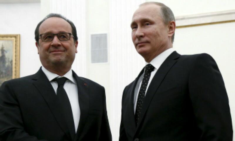El presidente francés y su homólogo ruso previo a su reunión este jueves. (Foto: Reuters)