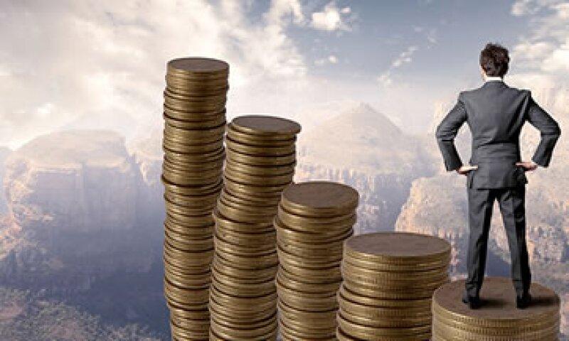 Los inversores ricos consideran que el fin del estímulo de la Fed impulsaría la economía. (Foto: Cortesía de CNNMoney)