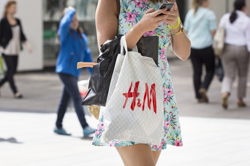 Hennes and Mauritz plastic bag shopping street sale