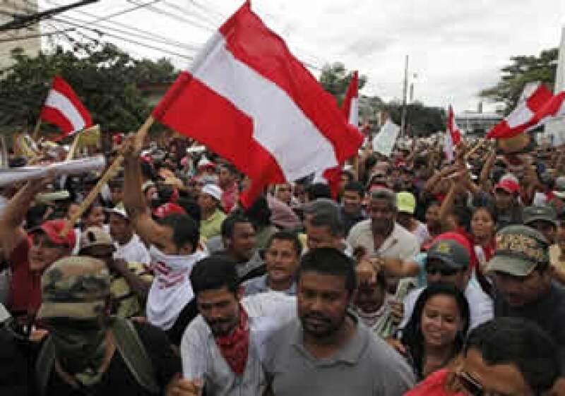 Las principales ciudades hondureñas viven seis días de protestas callejeras.  (Foto: AP)