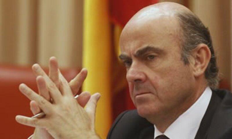 El ministro español de Economía, Luis de Guindos, ha presionado por la recapitalización directa a la banca. (Foto: AP)