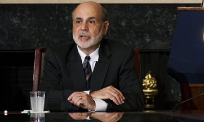 La entidad comandada por Ben Bernanke decidió mantener su tasa de interés entre 0.0% y 0.25%.(Foto: AP)
