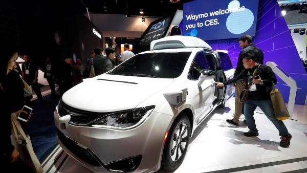 FILE PHOTO: FILE PHOTO: A Waymo autonomous vehicle (formerly the Google self-driving car project) is displayed at the Fiat Chrysler Automobiles booth during the 2019 CES in Las Vegas