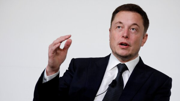 FILE PHOTO: Elon Musk, founder, CEO and lead designer at SpaceX and co-founder of Tesla, speaks at the International Space Station Research and Development Conference in Washington