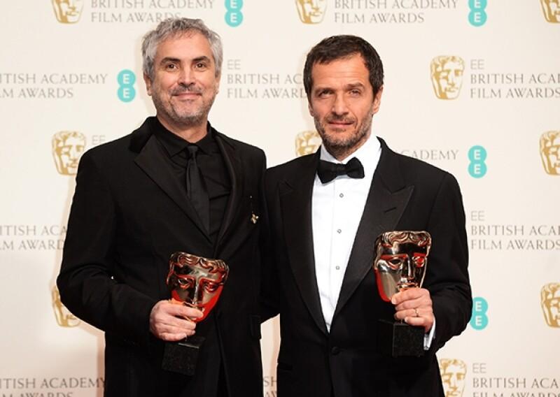 """El cineasta mexicano venció a Steve McQueen como Mejor Director y a """"Filomena"""" en Mejor Película Británica con """"Gravity""""."""