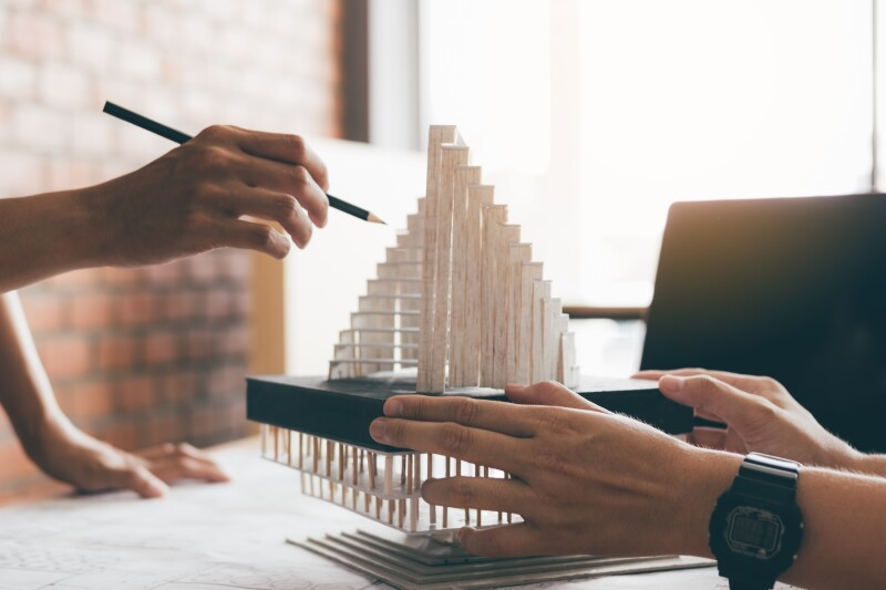 Architect reviewing architectural model in the office.