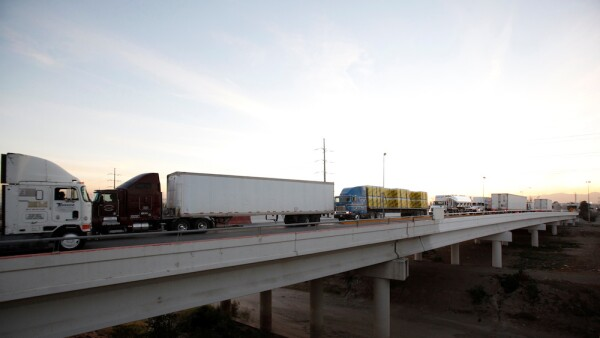 Trucks cross the international border bridge Zaragoza to El Paso, USA, and back into Mexico, in Ciudad Juarez