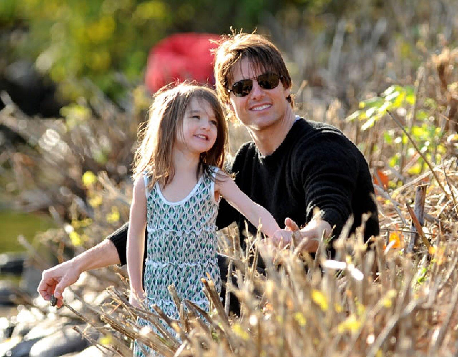 Con su papá Tom.