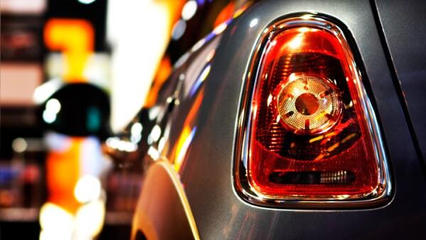 Mini Cooper vehicle at Night at public dealership shopping window