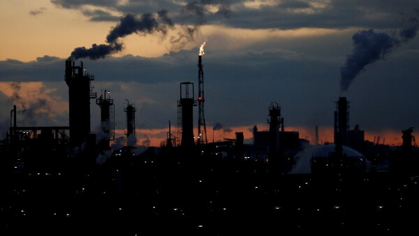 FILE PHOTO: Steam is emitted from factories at sunset in Keihin industrial zone in Kawasaki