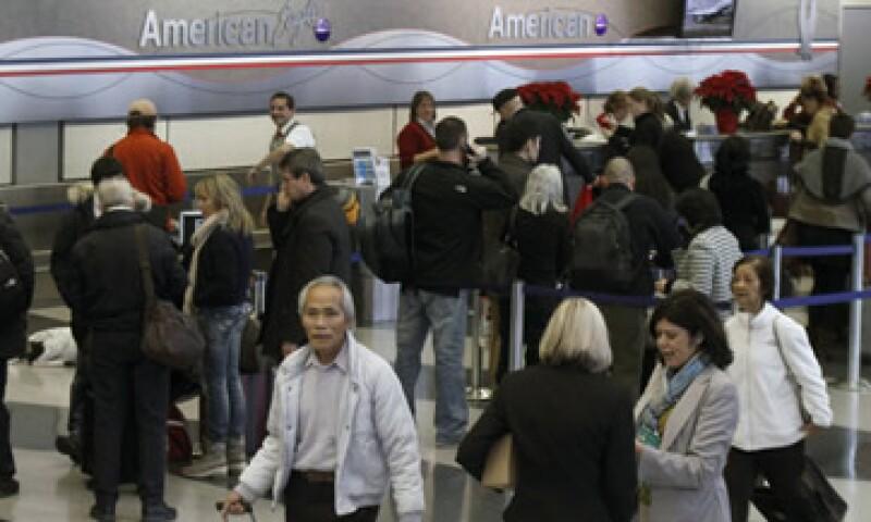 La empresa controladora de American Airlines enfrenta pasivos por 29,550 millones de dólares. (Foto: Reuters)