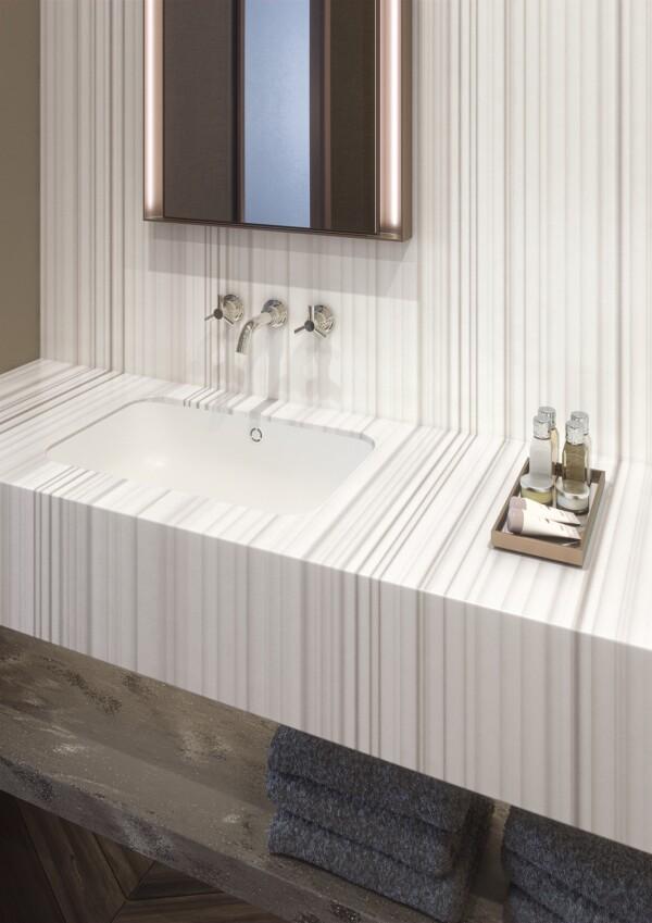 Lavabo en cuarto de hotel en Corian® Solid Surface Silver Linear