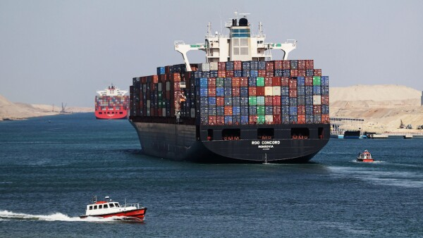 Container ship RDO Concord sails through the Suez Canal as Egypt celebrates the 150th anniversary of the canal opening in Ismailia