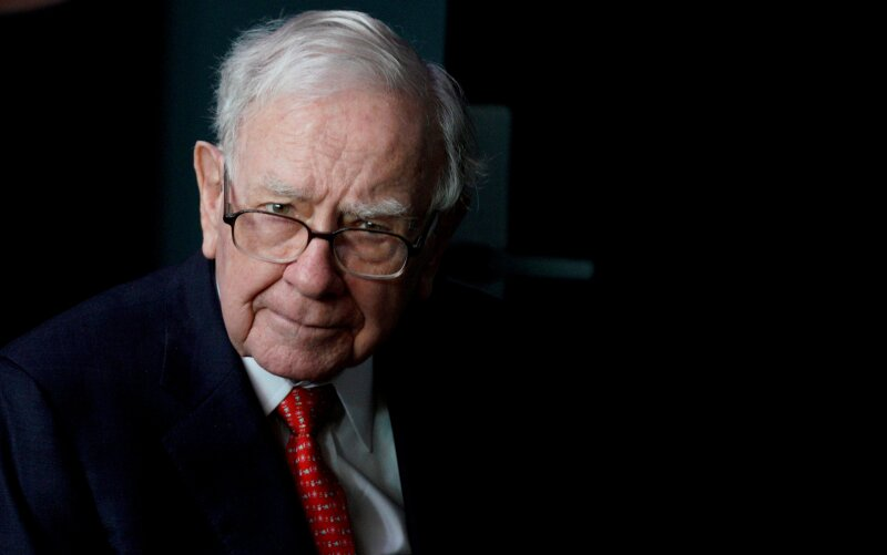 FILE PHOTO: Buffett, CEO of Berkshire Hathaway Inc, pauses while playing bridge as part of the company annual meeting weekend in Omaha
