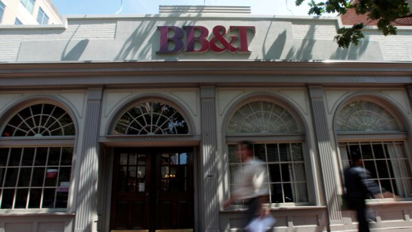 FILE PHOTO: People walk past a BB&T bank in Alexandria, Virginia