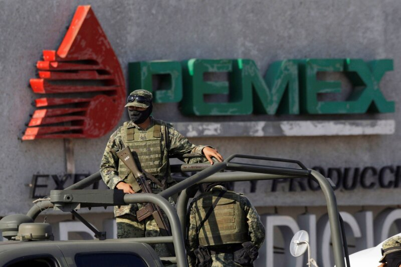 FILE PHOTO: Soldiers keep guard a gas facility of Pemex in Reynosa