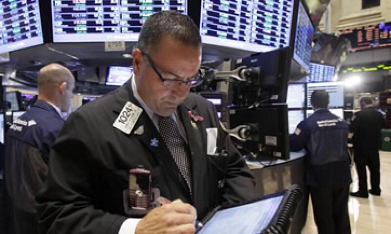 Contrario a lo que se piensa, los operadores de alta frecuencia contribuyen a combatir la volatilidad de la Bolsa. (Foto: AP)