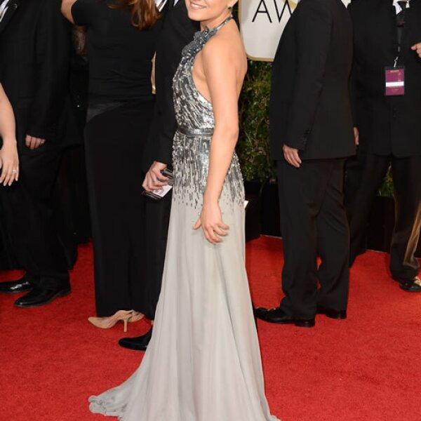 Mila Kunis mide 1.63 metros, pero hace pasar desapercibida su estatura con discretos tacones.