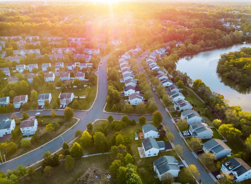 Wide panorama, aerial view with tall buildings, residential quarters in the beautiful sunrise