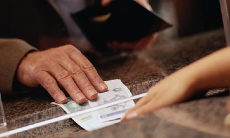 El cliente debe acudir a la sucursal o establecimiento para cancelar. (Foto: Getty Images)