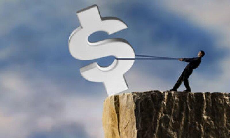 El abismo fiscal son aumentos de impuestos y recortes al gasto que entrarían en automático en enero de 2013 si no se llega a un acuerdo para evitarlo.  (Foto: Getty Imagesç)