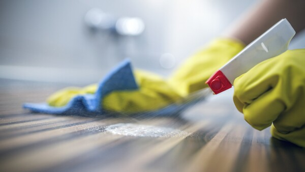 Cleaning kitchen table  with blue cloth