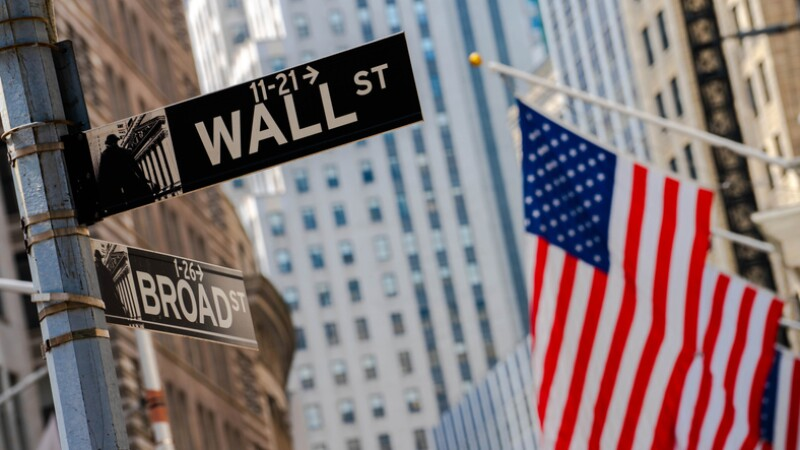 Flag and Wall street sign