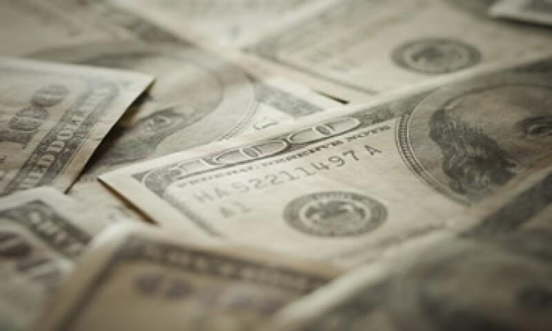 El dólar en bancos del DF cerró la jornada en 13.55 pesos, 25 centavos más que el cierre del martes pasado. (Foto: Photos to Go)
