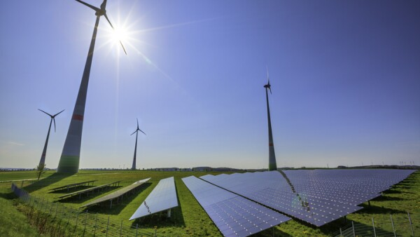 renewable energy: wind turbines and modern solar panels (HDRi)