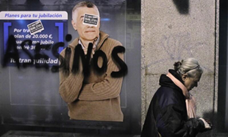 El suicidio de la mujer de 53 años ha provocado protestas ciudadanas contra el sistema bancario. (Foto: AP)