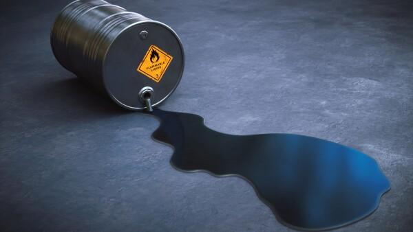 Leaking oil barrel spilling gasoline on the ground