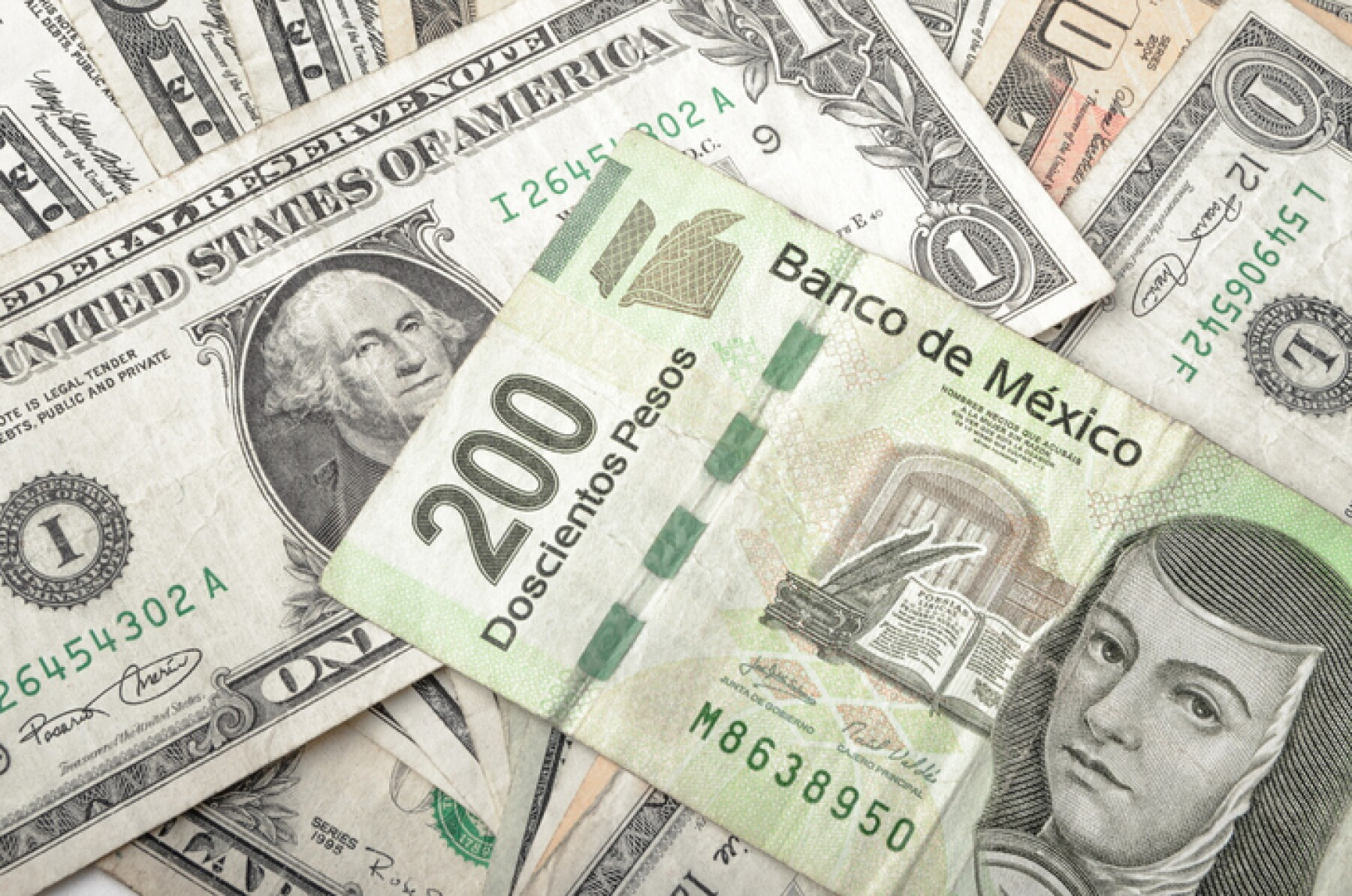 Dollar and Mexican Pesos Bills